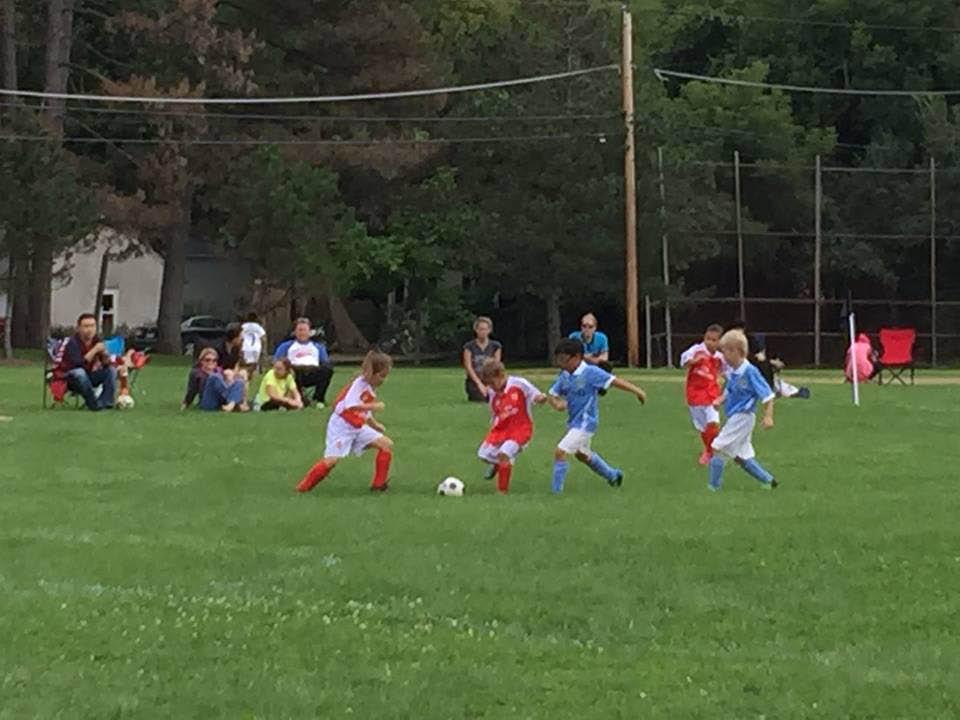 Kids practice soccer near Highland Park, IL