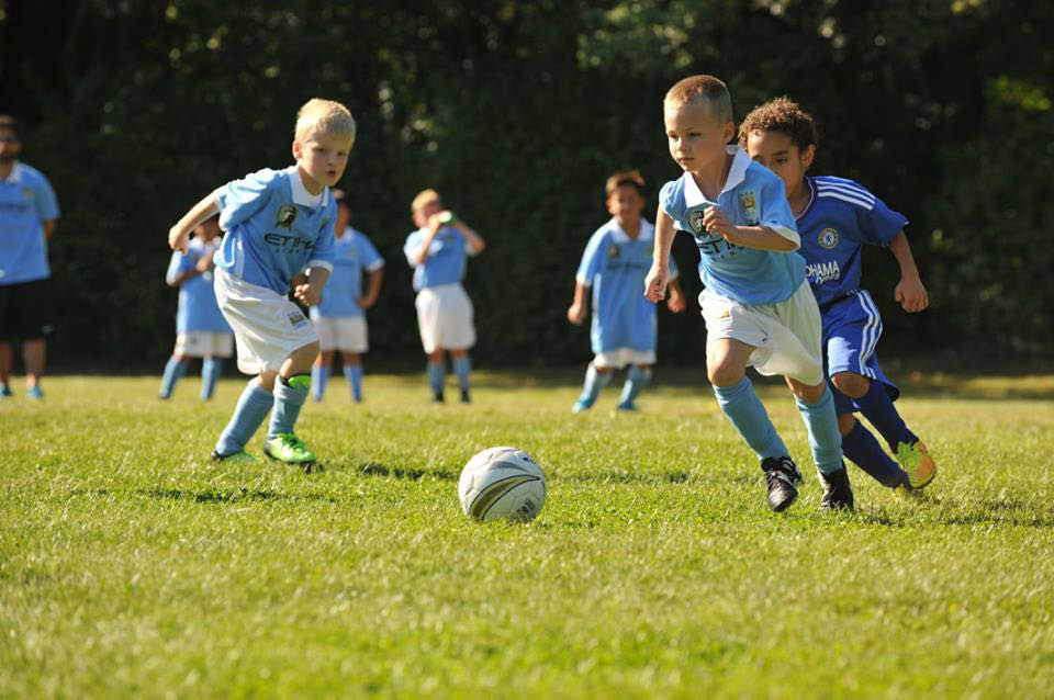 Kids learn soccer positions near Wilmette