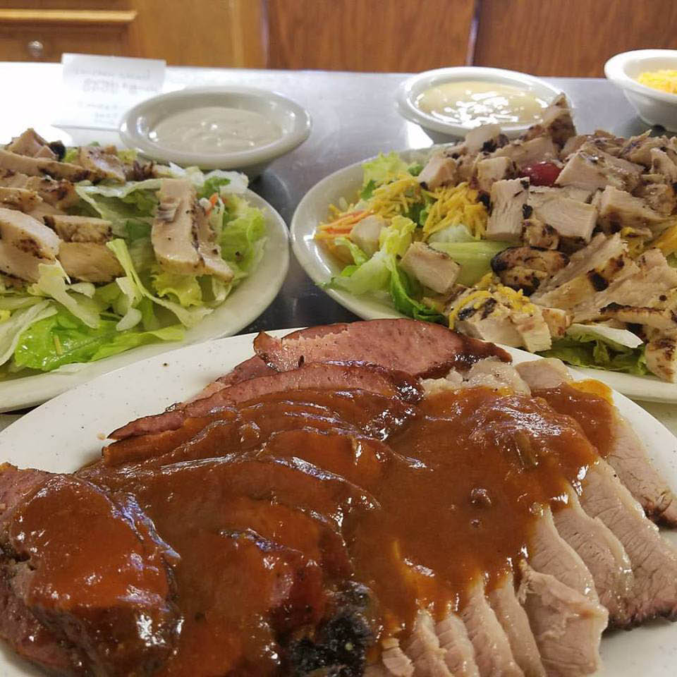 Meats with gravy and a chicken salad near Webster