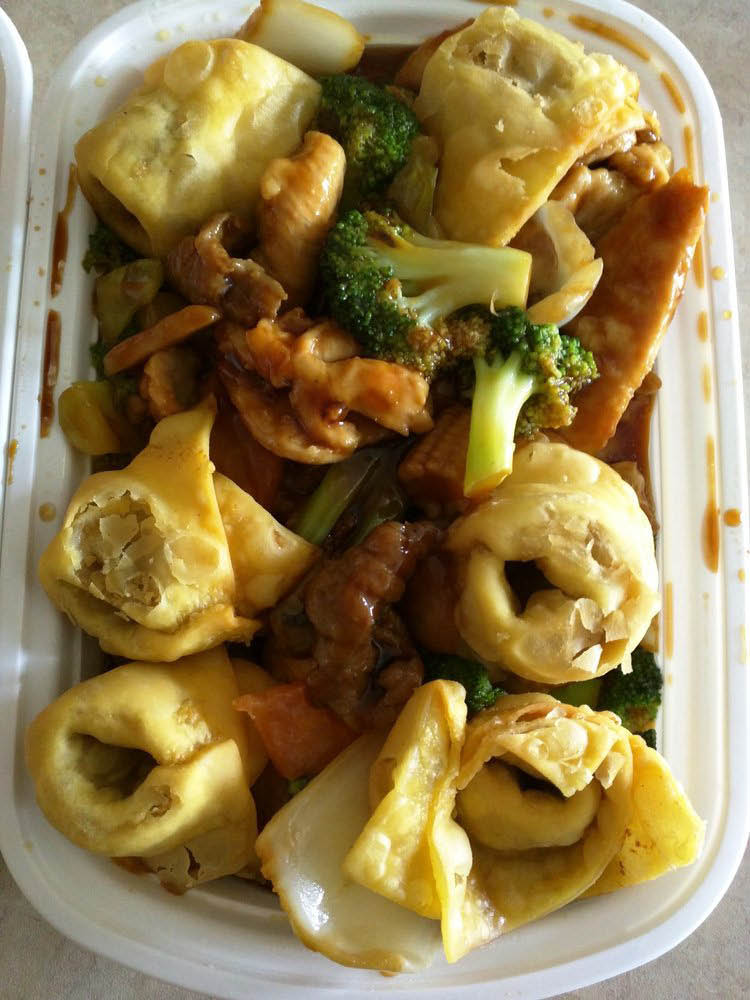 Pork dumplings with chicken, broccoli and bok choy