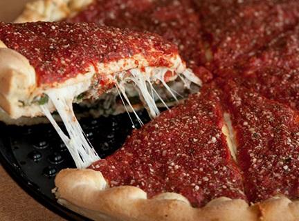 Slice of deep dish pizza at Maciano's Pizza;.