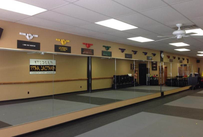 large martial arts mirrored classroom; youth martial arts training; kung fu; tai kwan do