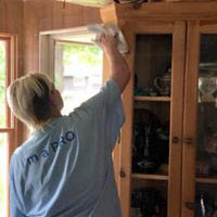 house cleaner dusting; cleaning wood cabinets; maid service near Savannah