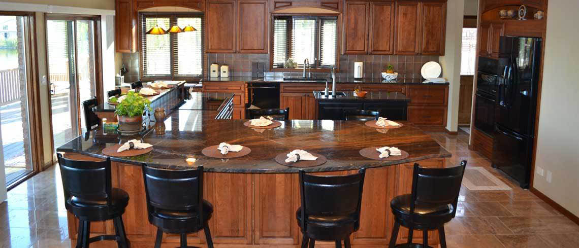 Gorgeous cabinets and counter tops in maple kitchen.