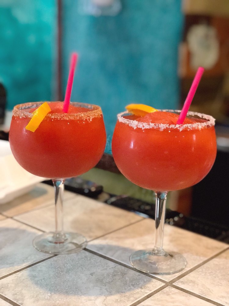 strawberry margaritas with pink straws