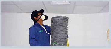 Master Duct Cleaning professional analyzing HVAC systems