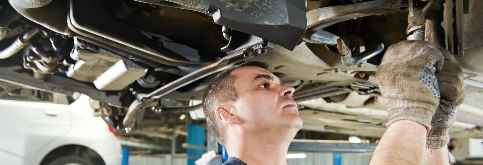 Mechanic working under car.