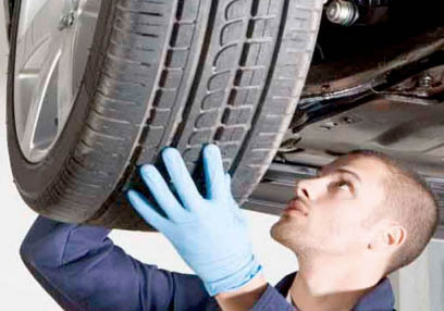 Replace and repair flat tire on automobile.