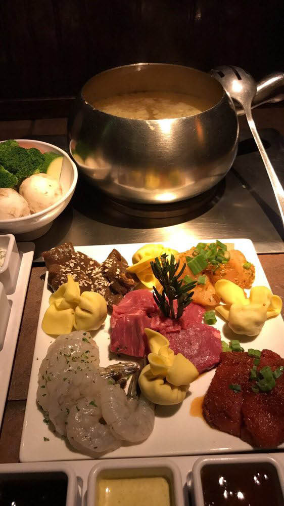 Meat, seafood and fresh veggies with a court bouillon style fondue