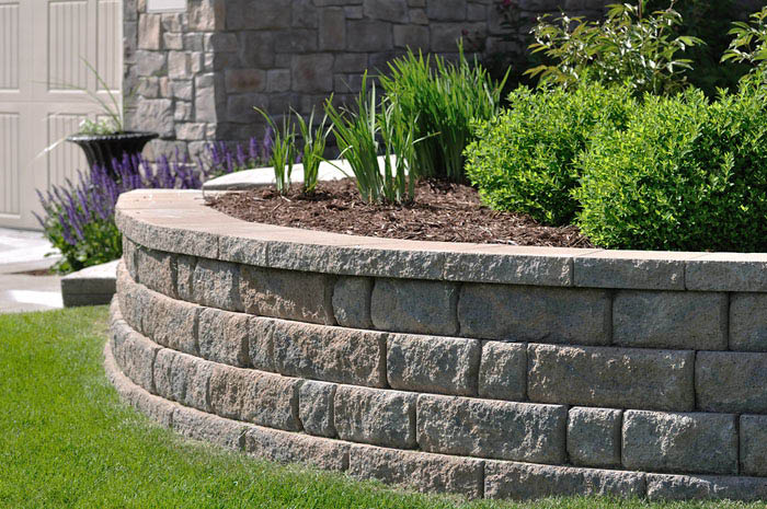 Photo of hardscape services performed by MG Boehm Landscaping in McDonald PA near me flowers trees walls
