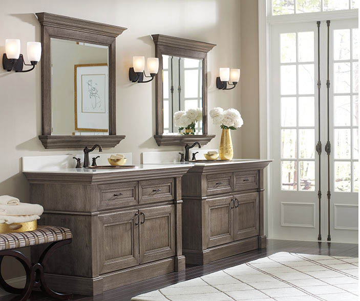 Bathroom designed with wood cabinets and vanity mirrors in Frederick, MD
