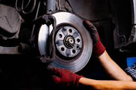 New brakes being installed at a Midas in New York