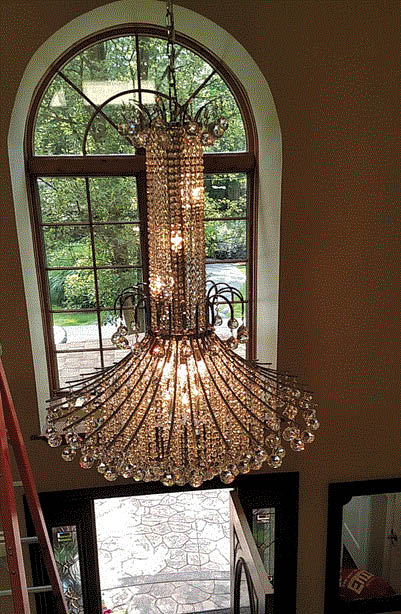 Picture of Chandelier being cleaned by Michigan Elite Window Cleaning