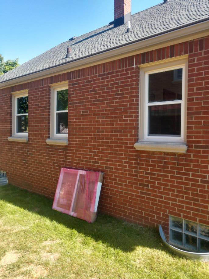 New Windows and siding on exterior by MKE Remodeling
