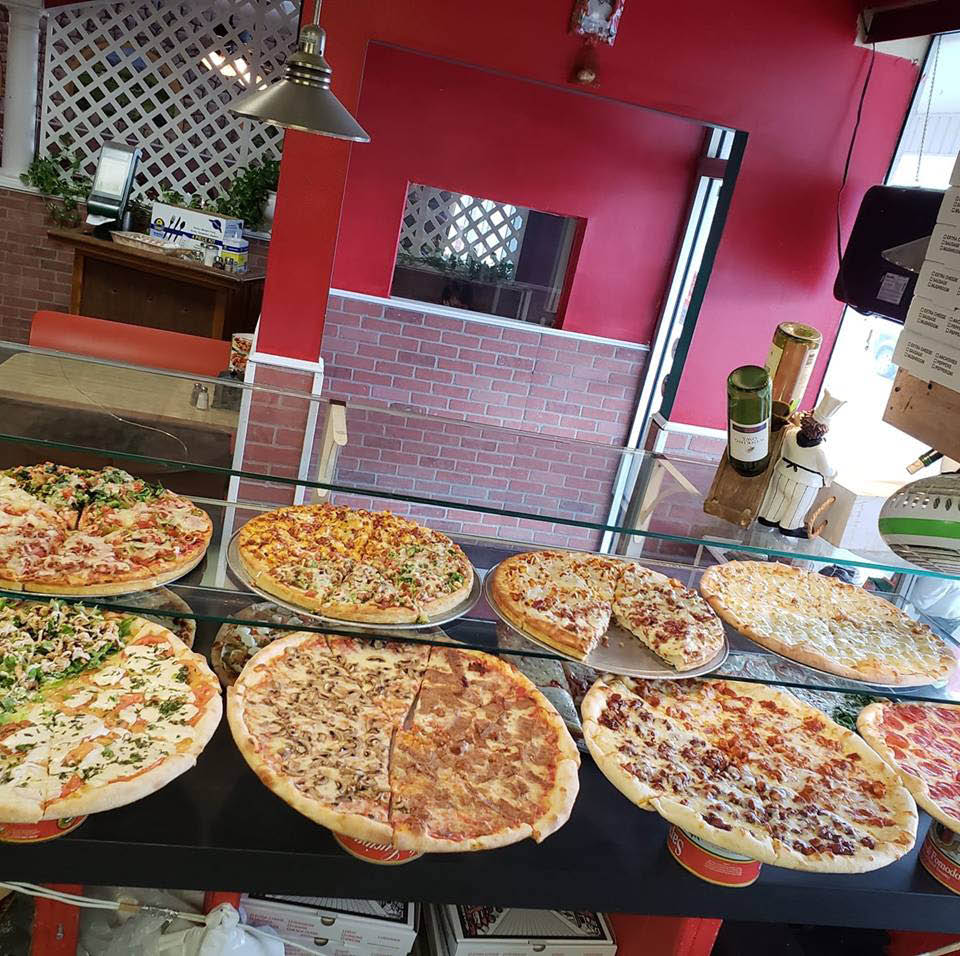 A variety of specialty pizza options from Marinelli's Pizza