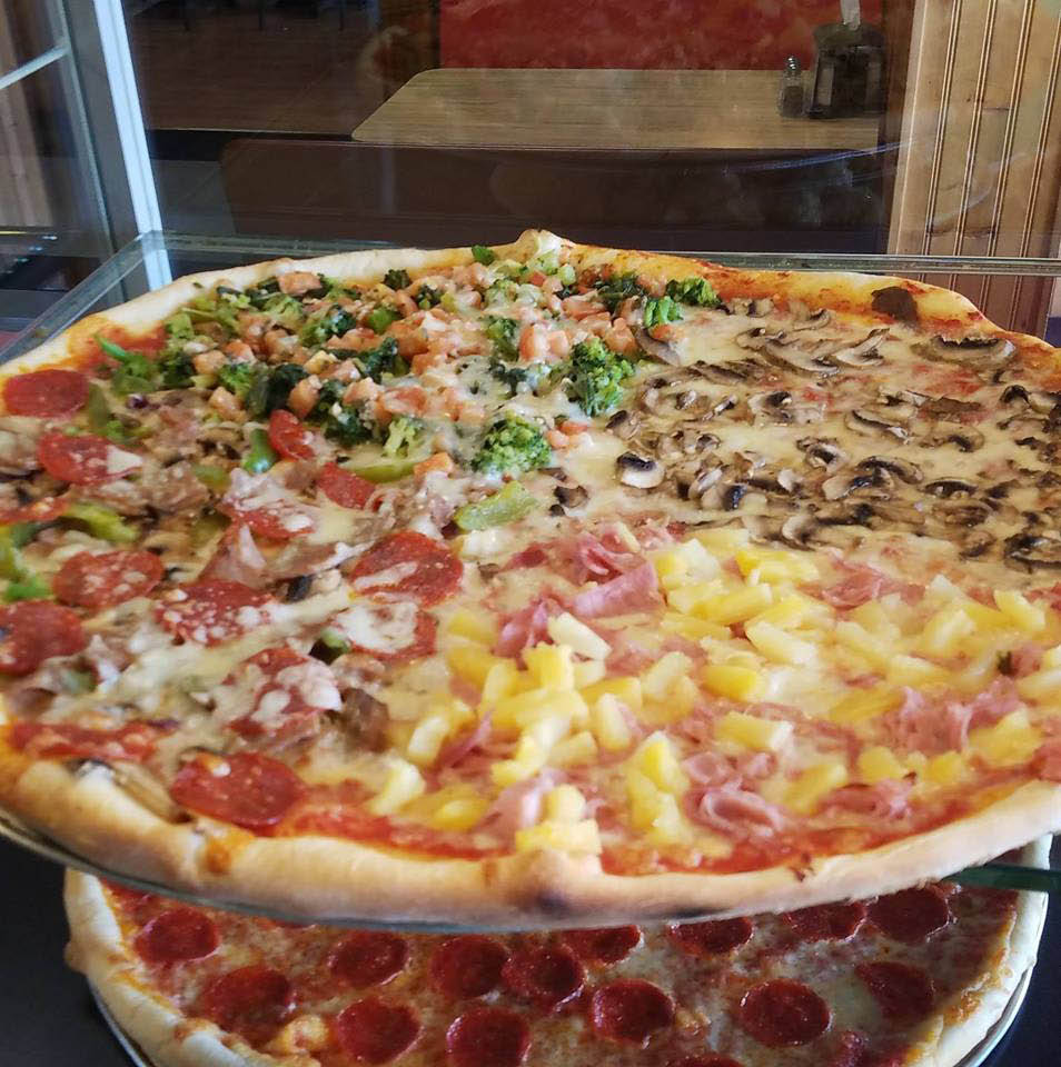 Four-seasons pizza: Hawaiian, mushrooms, vegetable special, and pepperoni pizza