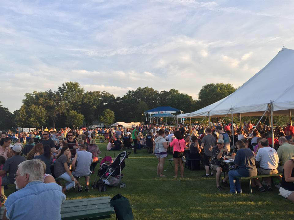 Happy crowd at Blues, Brews & BBQ's in McHenry, IL.in August