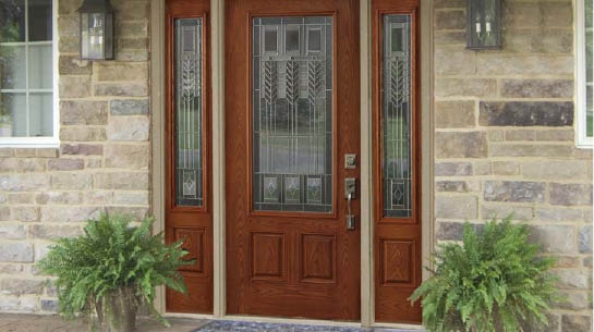Wooden front door with stained glass accent