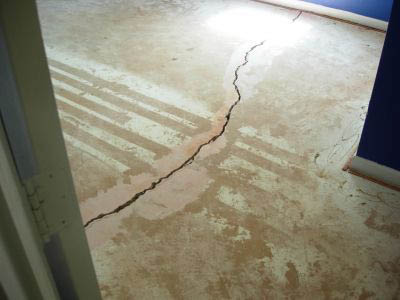 large and dangerous crack in a floor