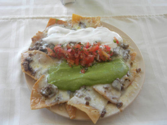 Our nachos will blow your mind and make your belly so happy!