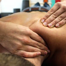 hands massage person's back at Natural Forces Massage in Humble, TX