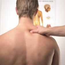 Hand massaging a person's shoulder; deep tissue massage near Houston, TX
