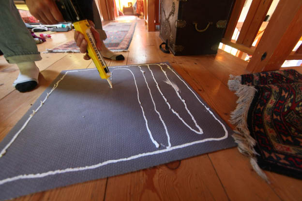 Nano-Grip will not harm area rugs or runners