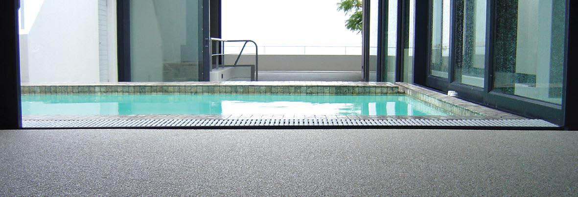 Anti-slip pool deck treated by Nano-Grip banner