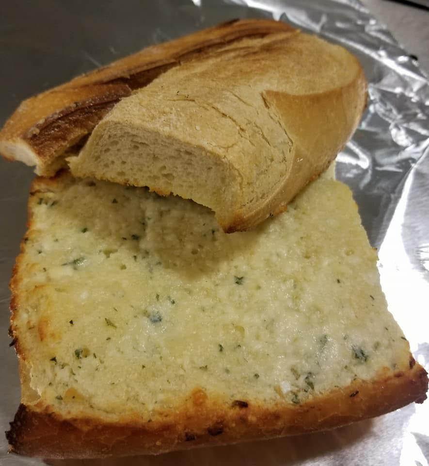 herb-seasoned garlic bread in basket.