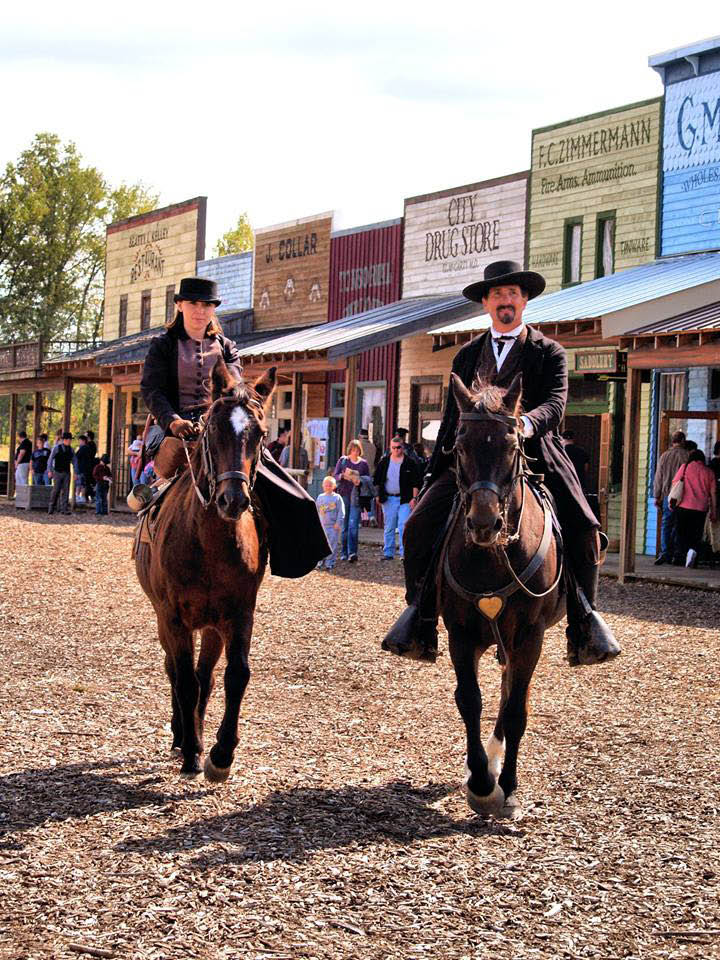 western rodeo cowboys riding horses