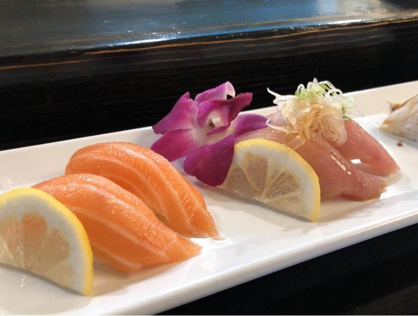 Salmon sushi over white rice