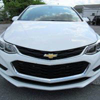 white Chevy sports car at Outten Chevrolet dealership in Allentown