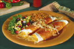 Papa Lopez serves delicious hot cheese enchiladas with rice & beans.