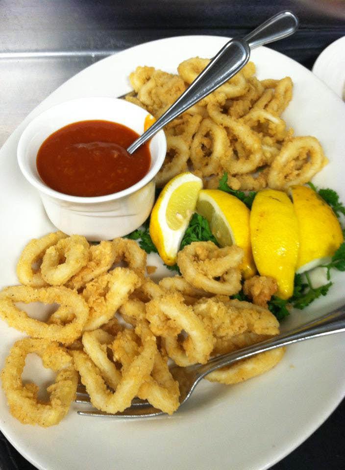 Plate of breaded calamari, lemon and sauce at Papa Joe's Chicago Ridge, IL..