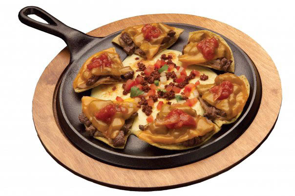Queso fundido and steak Garnachos appetizer served on a skillet at Pepe's Mexican Restaurant.