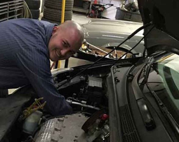 Mechanic performing engine repair and oil change service in Elk Grove Village IL