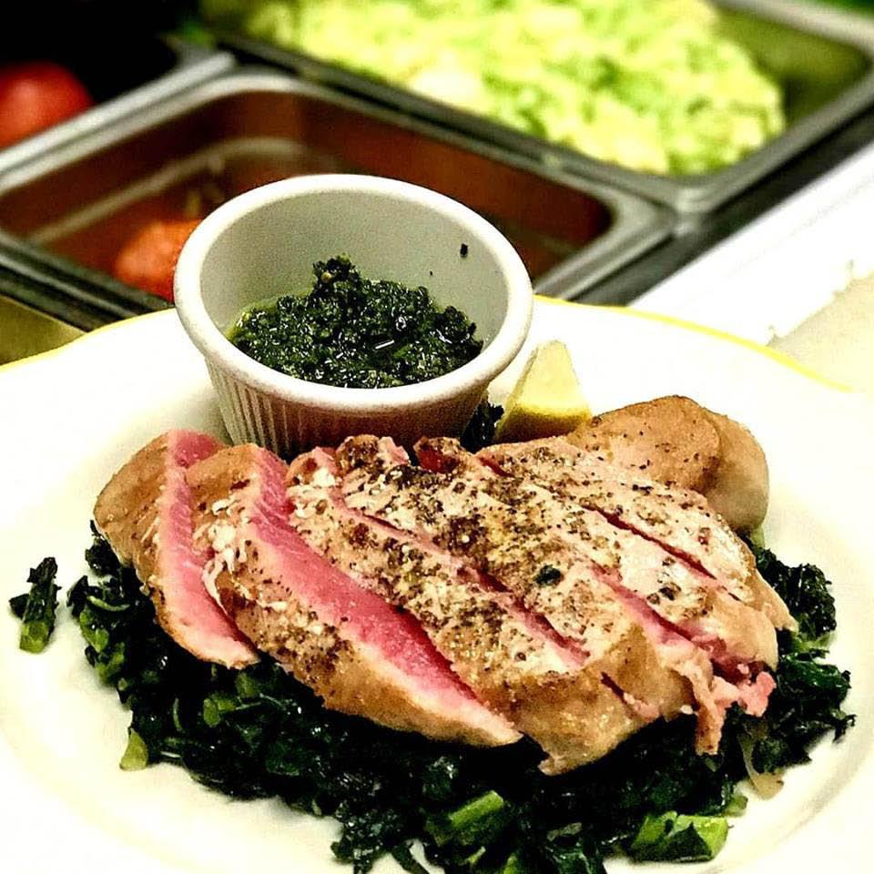 Fresh-seared ahi tuna over greens