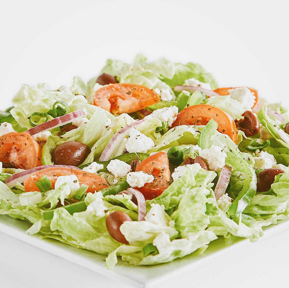 crisp, fresh salad on a white plate from Pizza Guys in San Pablo, CA