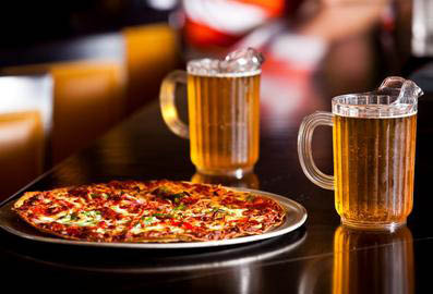 Enjoy any of Vince's specialty pizzas and a cold mug of beer