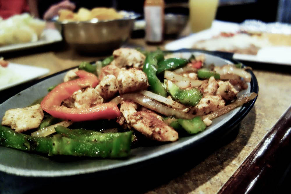 Sizzling plate of fajitas waiting for you to dive in