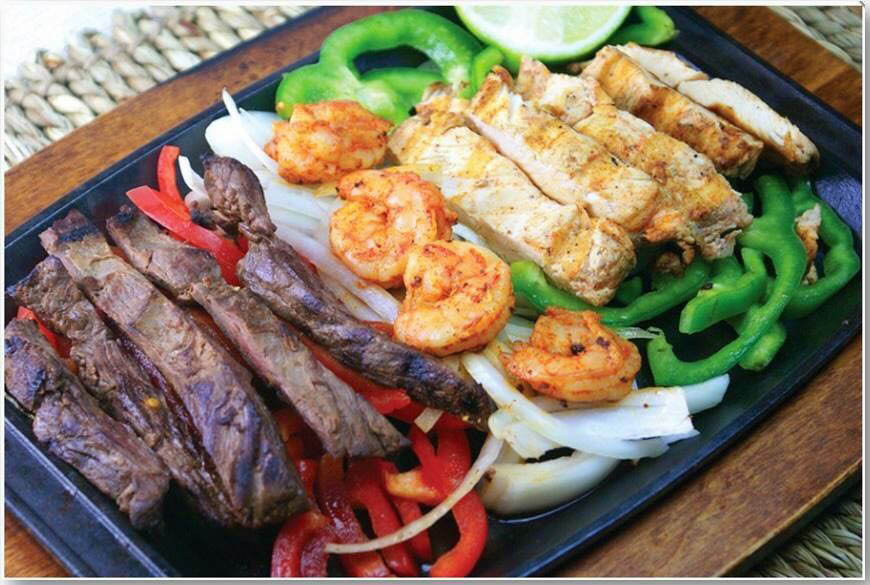 Try our sizzling fajitas. Choose from chicken, steak, shrimp and a whole lot of others.