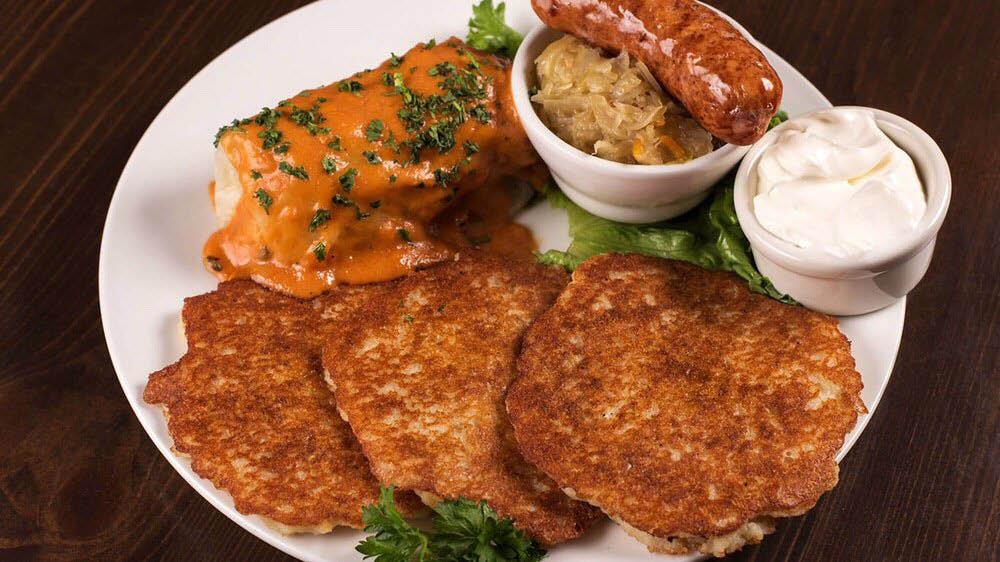 Polish Combo Plate (potato pancakes, stuffed cabbage & smoked sausage with sauerkraut)