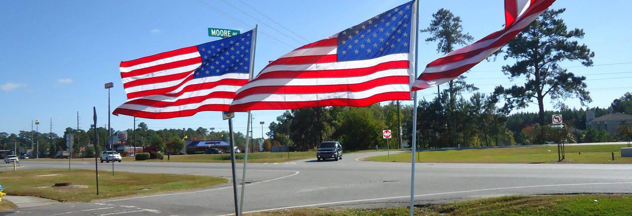 Pooler Lions Club American flags in Savannah GA banner ad