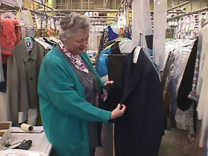 Garment finishing: checking for loose buttons, stains or pulled threads and dry clean bagging
