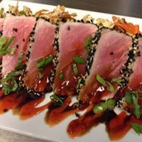 Plate of Ahi tuna slices with eel sauce; steak houses; fine dining