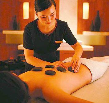 Discounted hot stone massage procedure near Woodridge