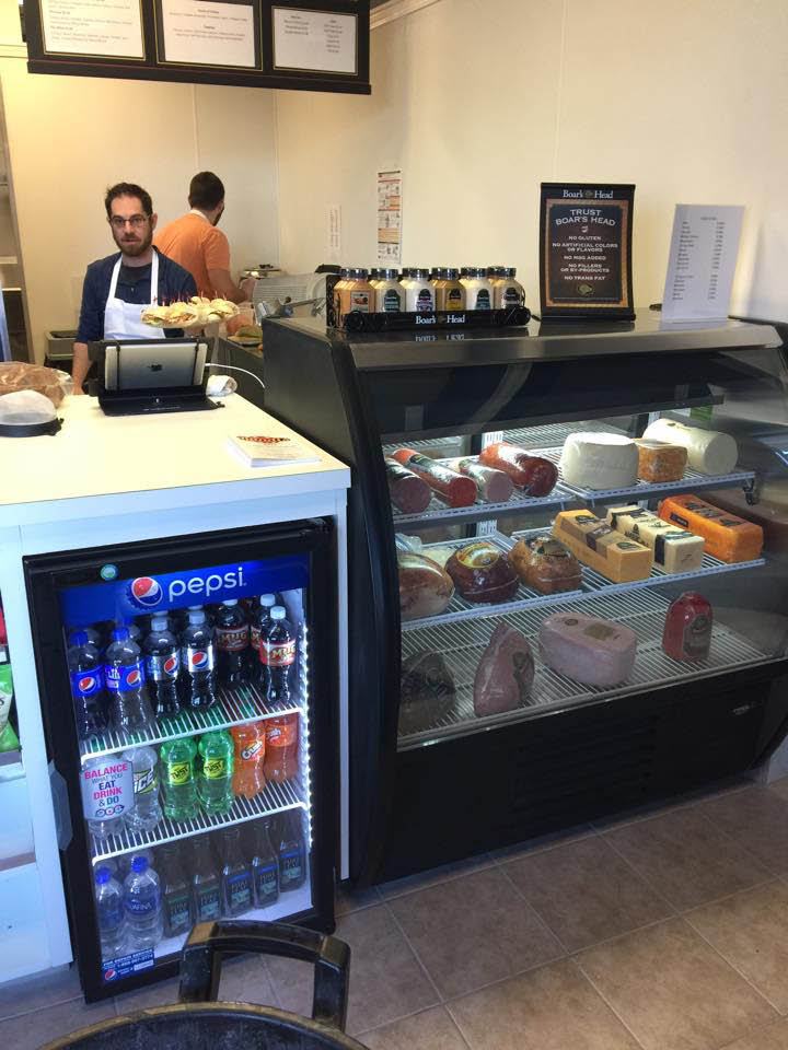 The deli counter at Randi's Deli serving Boar's Head meats.