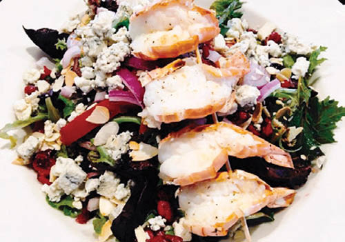 Salad with lobster skewers, blu cheese, peppers and more.