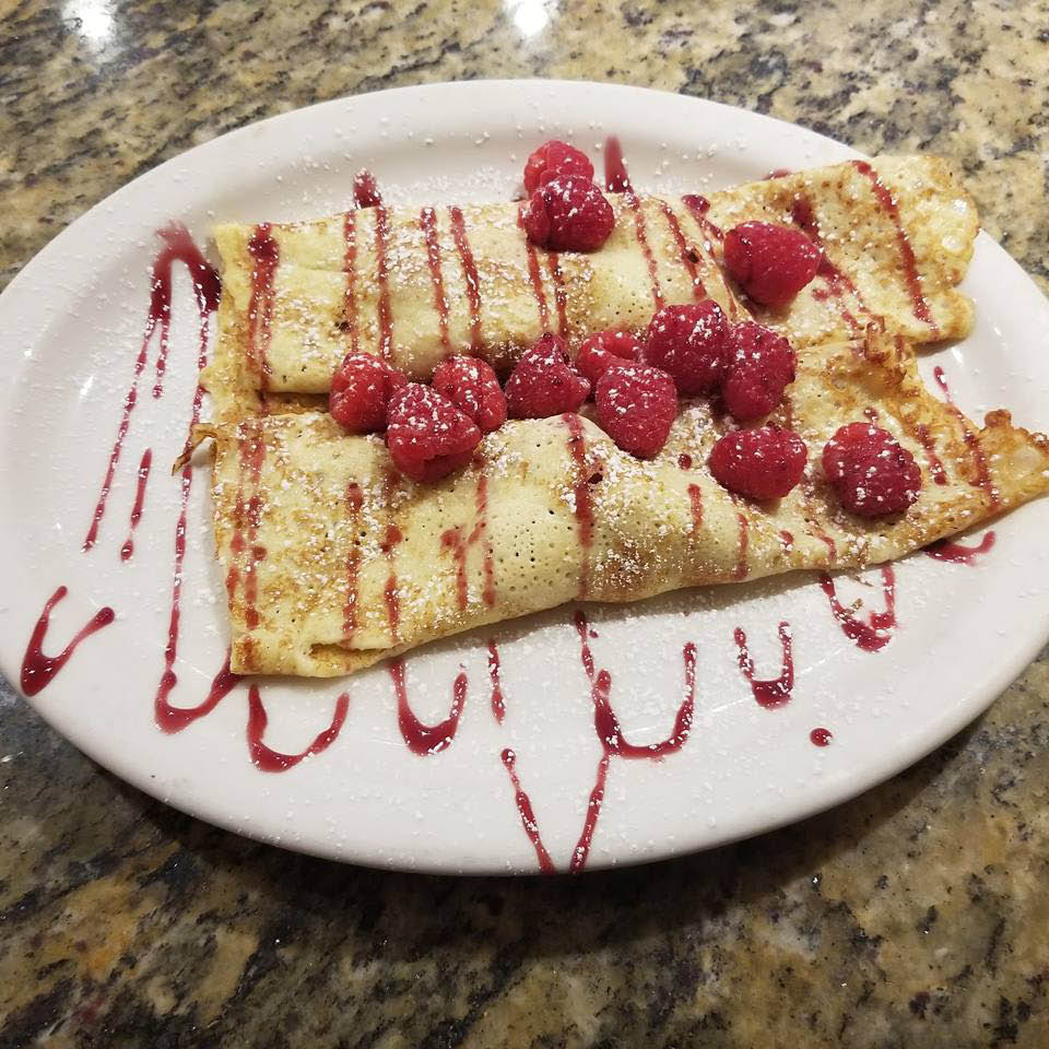 Raspberry crepes served hot!