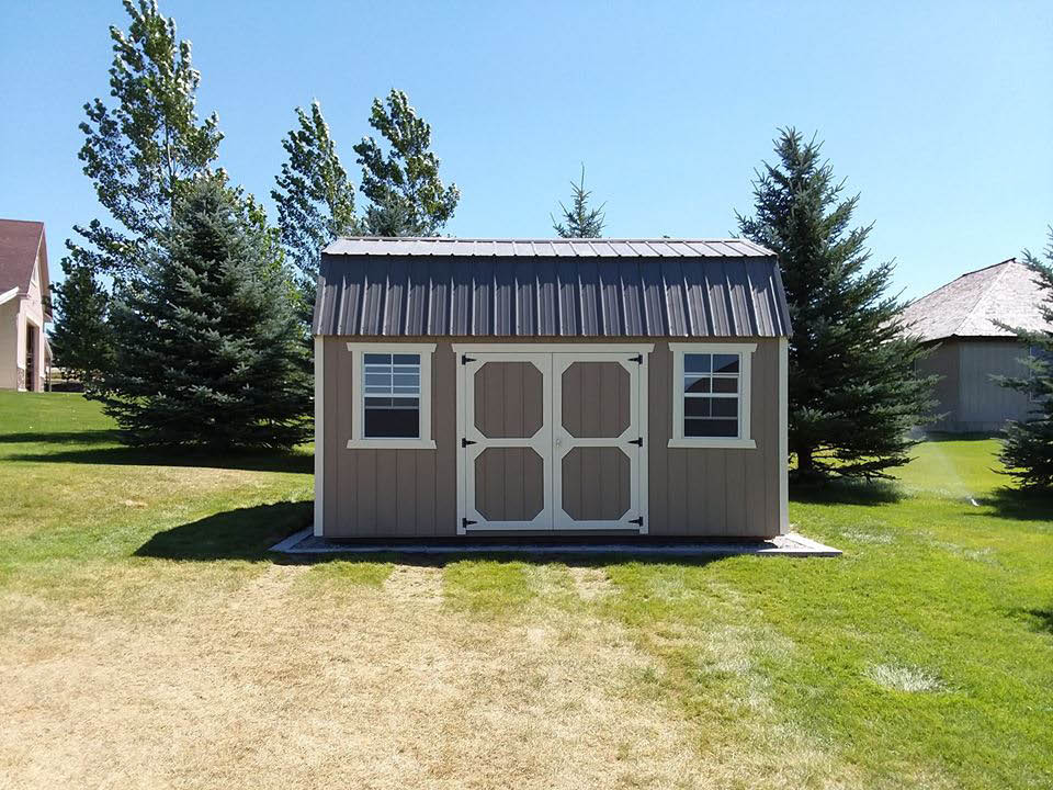 Lofted storage shed with windows and double doors